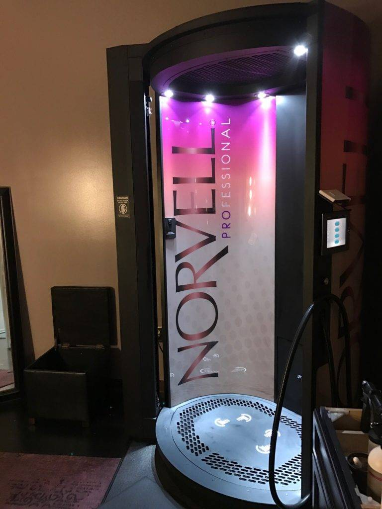 Norvell Auto Revolution Plus can be used for handheld airbrush tans or for private automated spray tans.