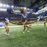 Detroit Lions Cheerleader, Amber Morfitt, doing toe touch